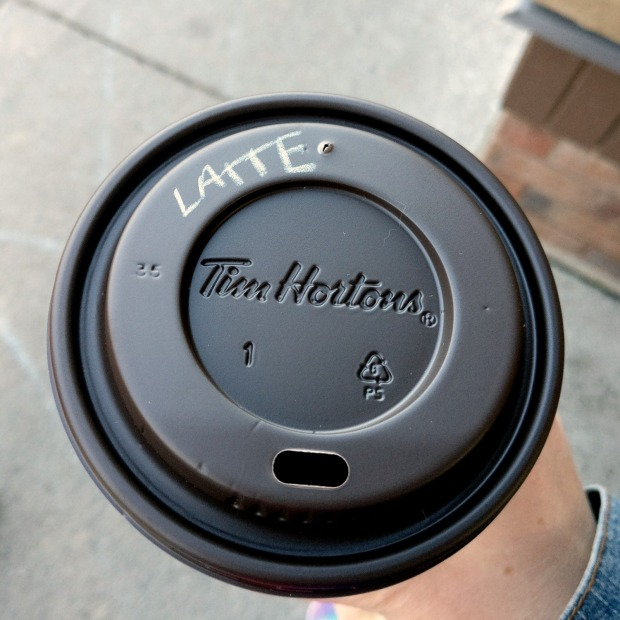 Top View Tim Hortons coffee latte written on lid.