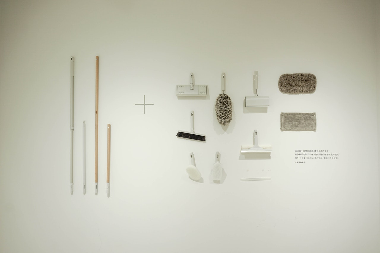 white-brushes-and-mops-on-white-surface-1676037